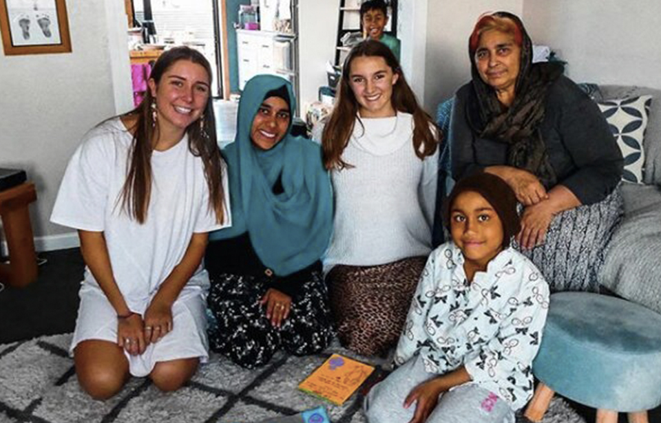 Creator of Cards for Community, Maddie Mason, with a South Island Muslim family who invited her into their home to create cards with them. Photo: Supplied