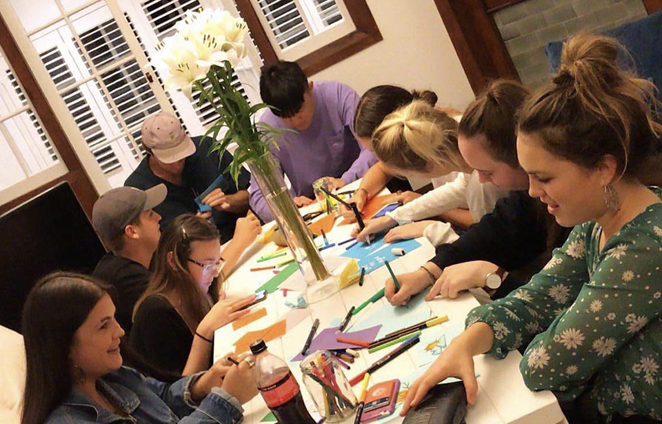 Isabella Kippenberger, who hosted a Cards for Community event, said her event involved sitting around the dining table and using coloured paper and felt pens as tools to write cards of support and solidarity. Photo: Supplied