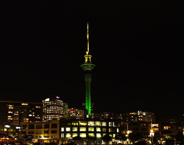 City painted green and yellow by Auckland landmarks