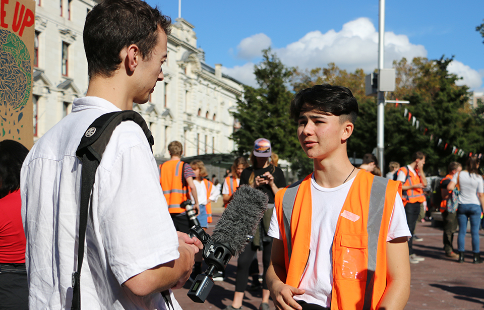 Auckland School Strike 4 Climate co-ordinator Luke Wijohn, 17, speaks to the media on Friday before the march down Queen St.