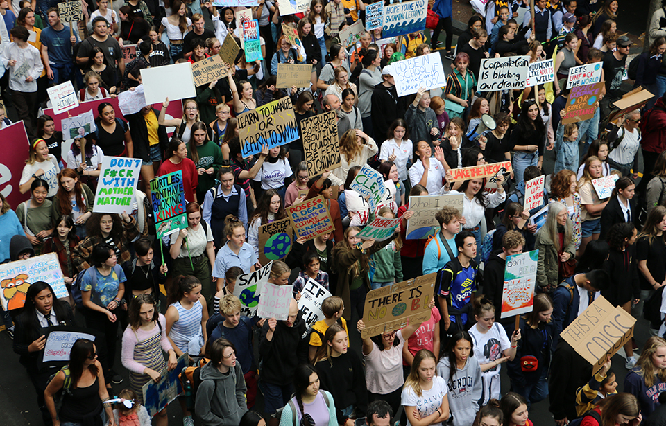 About a thousand School Strike 4 Climate protesters disrupted traffic on Queen St demands action on climate change.