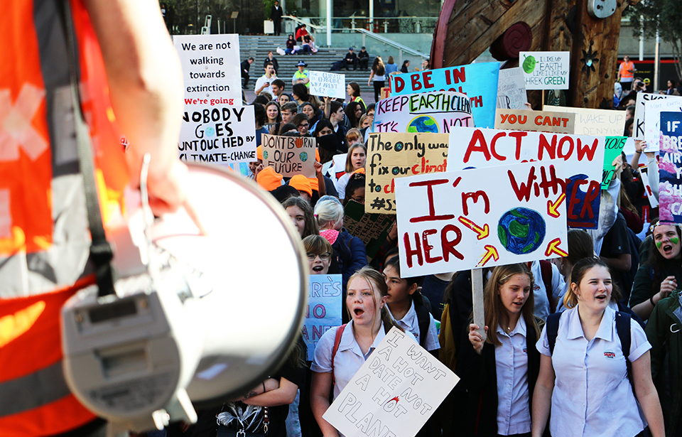 Organisers brief protesters for the second Auckland School Strike 4 Climate at Aotea Square at noon before they down Queen St towards Britomart.